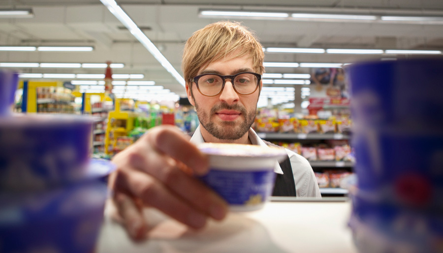 Man taking product from shelf