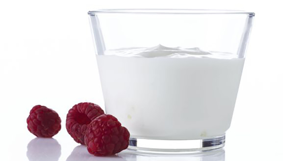 Portion of creamy yogurt with raspberries