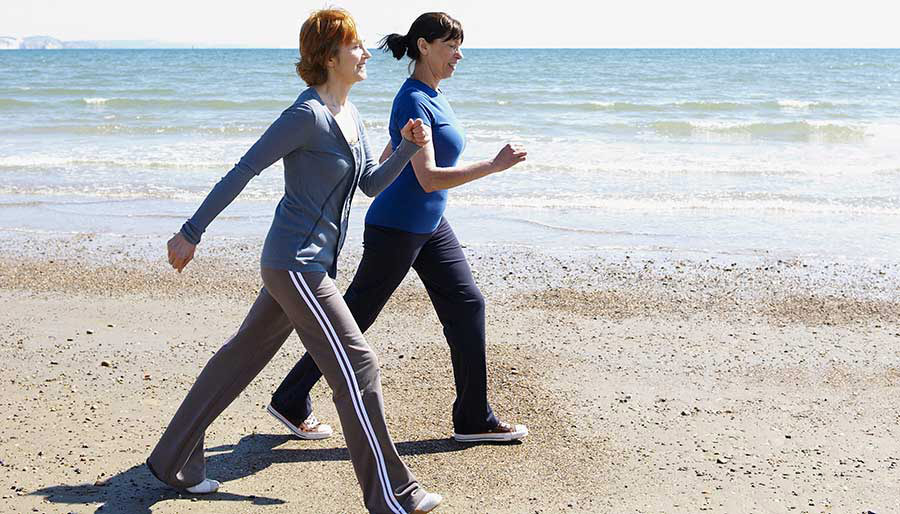 Two women walking on a beach