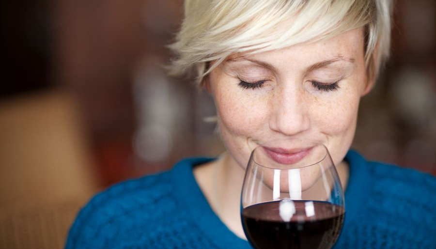 Blonde woman drinking redwine