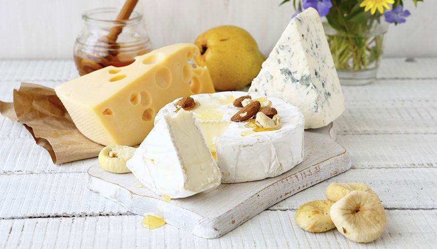 Assorted cheeses with honey and lemon