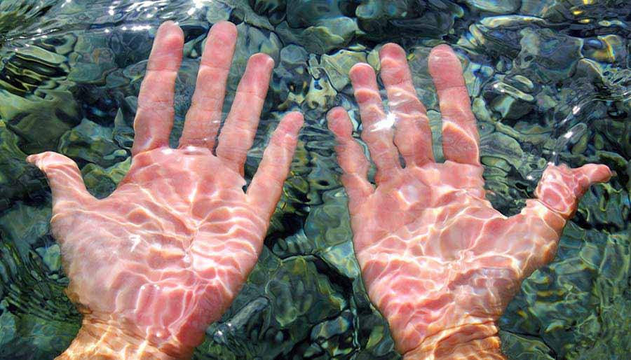 Hands in water