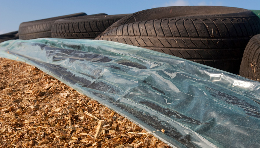 Silage framed by plastic and tires